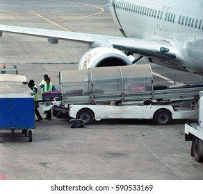 3 Jan 2017: Yangon, Myanmar - Luggage or baggage are unloading from the plane by airport ground staffs.