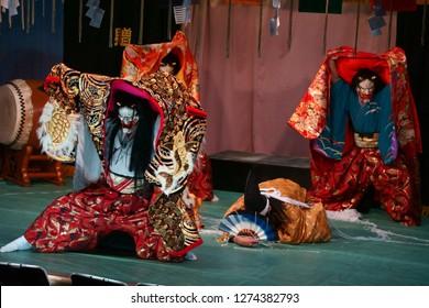 "3 Japanese demons bullying an innocent man in Kagura performance. ""贈"" means present."