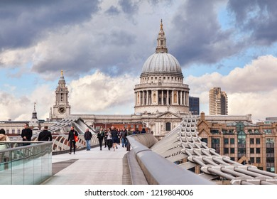 3 March 2015: London, UK - St Paul's Cathedral from the Millennium Bridge,  under a dramatic sky.