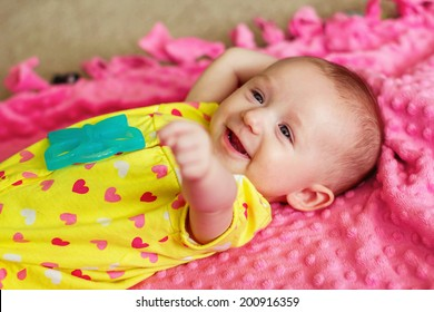 3 month old baby girl lying on blankets -- image taken in Reno, Nevada, USA