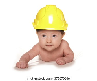3 Month old baby wearing builders hard hat cutout