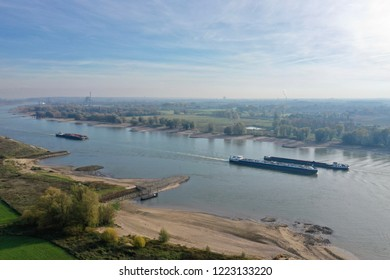 3 November 2018: Nijmegen, the Netherlands; aerial view of the river Maas with low water due to drought and ships passing on a sunny autumn day
