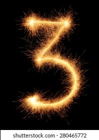 """""""3"""" number drawn with bengali sparkles isolated on black background"""