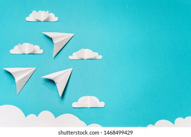 3 origami planes and paper cut sky with clouds. Craft objects for banners/landing pages/backgrounds design with copy space.