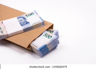 3 packages of 500 Mexican pesos bills inside a paper bag