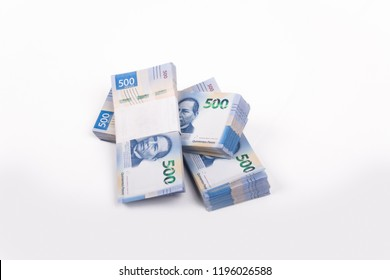 3 packages of 500 Mexican pesos bills on white