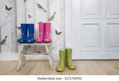 3 pairs of colourful wellingtons kid's boots rubber boots rain boots in the lounge hall