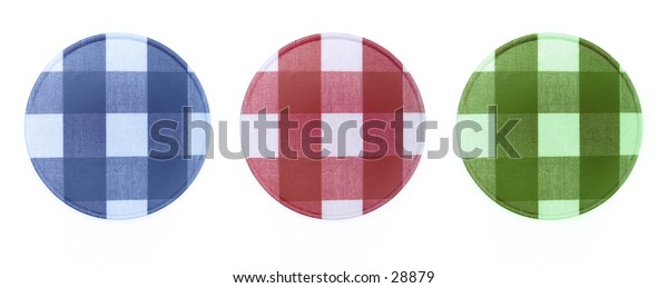 3 plaid coasters on a white background. Blue, red and green.