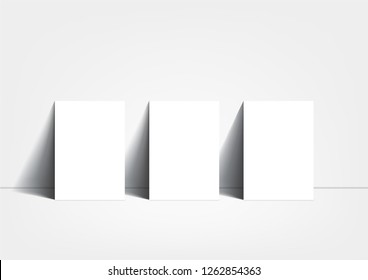 3 poster mockup on white background, on floor, A3 size