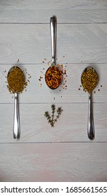 3 spoons with chilli and seeds