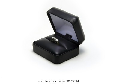 3 stone diamond ring in a jewelry box