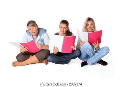 3 students talking while holding their copybooks.
