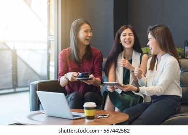 3 teenagers friends meet in coffee shop, using technology device have fun