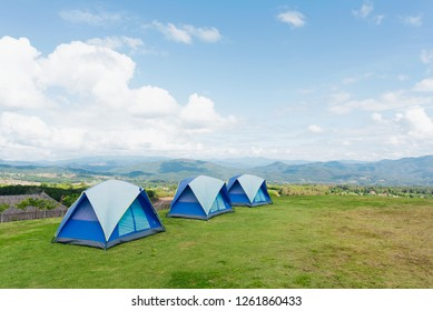 3 tents on top of the mountain over looking beautiful scenery
