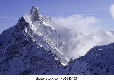 3 valleys peak and lift on skyline, France