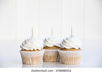 3 white cupcakes with stick for toppers. Cupcake mock up