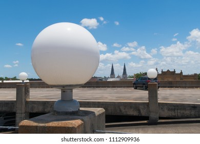 3 white globe lamps on the top of a parking garage