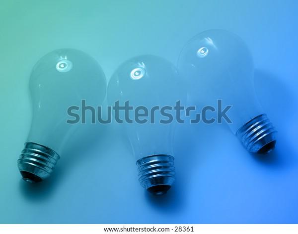 3 white, matte light bulbs on blue/green background.