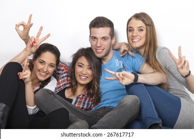 3 woman and 1 man showing victory sign with their hands