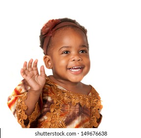 3 year old African American girl in colorful costume with laugh happy expression