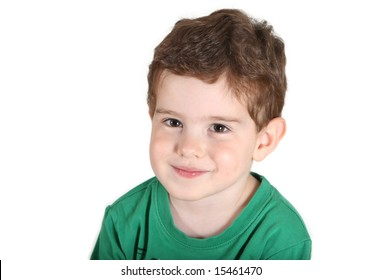 3 year old boy looking at camera, smiling, wears green