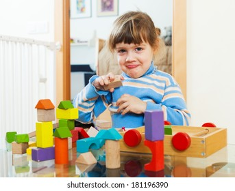 3 years child playing with toys in home interior