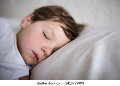 3 years old toddler boy sleeping on bed. Closeup