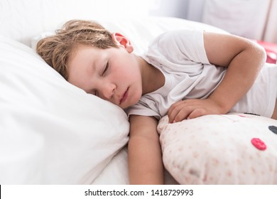 3 years toddler boy sleeping the siesta on bed. Selective focus