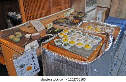30 December 2018 : Kyoto Japan. Street food stall sellting freshmade daifuku or japanese sweet sticky stuffed rice ball during new year festival period.