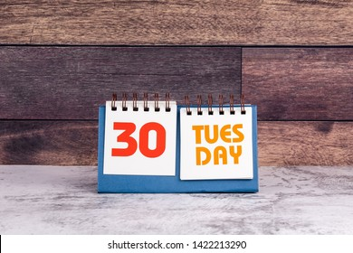 30 July, Tuesday, 2019. International Day of Friendship. Marble table and wooden background
