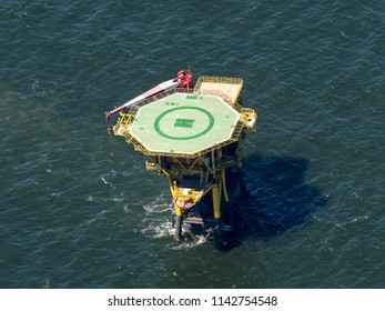 30 June 2018, Ameland, Holland. Aerial view of offshore construction platform for production of oil and gas in the Waddenzee, a unesco world heritage site. The drilling is operated by Shell and NAM.