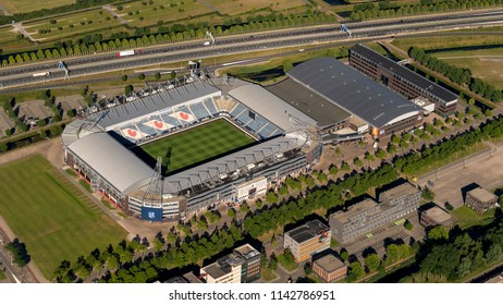 30 June 2018, Heerenveen, Holland. Aerial bird view of soccer stadium ABE LENSTRA STADION in the dutch province Friesland. The logo of the Frysian flag is visible on the seats of the tribune.