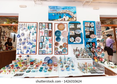 30 May 2019, Lindos, Greece: Greek ceramics and other souvenirs for sale at the streets of old town of Lindos. Greek traditional handcrafts