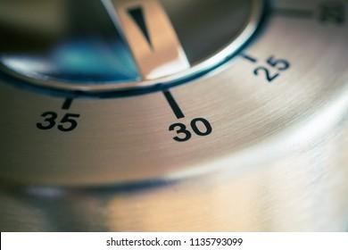 30 Minutes - Macro Of An Analog Chrome Kitchen Timer