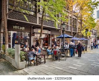 30 November 2018: Shanghai, China - Pavement cafe in the Xintiandi area of Shanghai, now an important shopping and leisure centre.