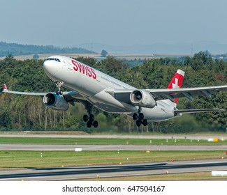 30 September 2016 Big Airbus A330 Swiss Airline take off from Zurich Kloten Airport, Switzerland. This type of aircraft is used for long haul flight.