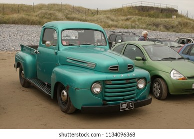 30 th June 2018- A classic 1948 American Ford Pick-up parked on the sandy beach at Pendine, Carmarthen, Carmarthenshire, Wales, UK.