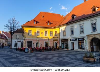 30.03.2021 Sibiu, Romania. Historic city center of Sibiu, restaurants and pubs.