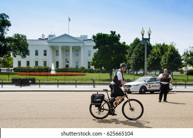 30.08.2016. Editorial photo. View on the white house during the summer day. Residence of the president of United States of America. Patrol of the white house by police. Policeman on the bike