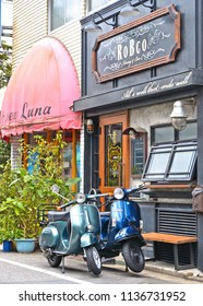 30.08.2017. empty street with two vintage motorcycles Vespa, old traditional architecture and houses in Tokyo periferic district , Japan
