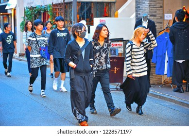 30.08.2017. group of Young fashionable asiatic people crossing street  in famous Shibuya district and Harajuku street, Tokyo Japan