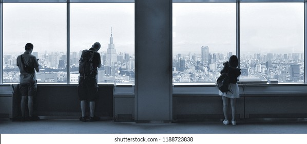 30.08.2017. people looking down on Tokyo cityscape and skyline from windows of Municipality Building observatory , Japan