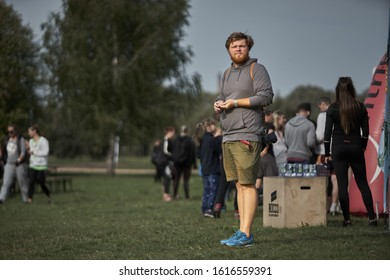 30-09-2019 Riga, Latvia A man in shorts stands on green grass