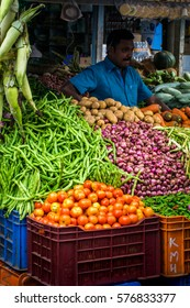 30/10/2016 Munnar, India, man on mixed fruit and vegetable food street market stall