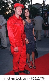 """30JUL98:  """"Friends"""" star COURTNEY COX & actor boyfriend DAVID ARQUETTE at the Hollywood premiere of """"Snake Eyes,"""" which stars his brother-in-law Nicolas Cage."""