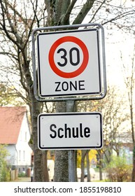 A 30km/h speed limit traffic road sign for a school area in Germany