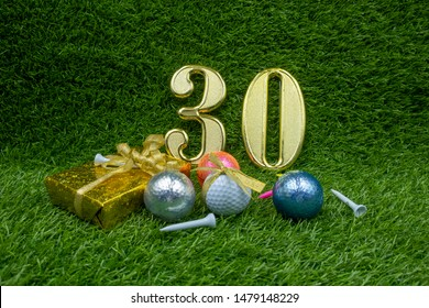 30th birthday Anniversary with gifts and golf balls are on green grass.