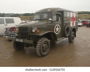 30th June 2018- A 1942 American Dodge military ambulance parked on the sandy beach at Pendine, Carmarthenshire, Wales, UK.