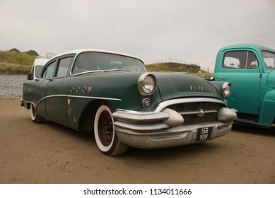 30th June 2018- A 1955 classic American Buick saloon car parked on the sandy beach at Pendine, Carmarthen, Carmarthenshire, Wales, UK.
