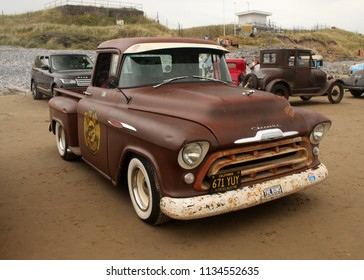 30th June 2018- A 1957 Chevrolet Pick-up parked on the sandy beach at Pendine, Carmarthen, Carmarthenshire, Wales, UK.